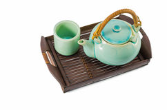 Chinese green teapot and teacups on the wooden trivet Royalty Free Stock Photo