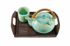 Chinese green teapot and teacups on the wooden trivet isolated Royalty Free Stock Images