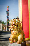Chinese guardian golden lion statue Stock Photography