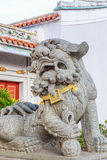 Chinese guardian lion in front of a Chinese temple. Chinese guardian lion statue set in front of a Chinese temple. It is believed to have a mystic protection Stock Photo