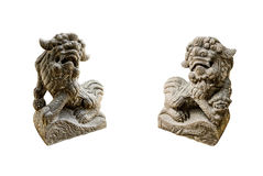Chinese guardian lion and lioness. With isolated background Stock Photos