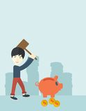 Chinese guy holding a hammer breaking piggy bank Stock Photos