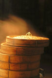 Chinese hamburgers recipients. Chinese hamburgers boiling in specific wooden recipients during a night street festival Stock Photography