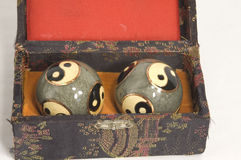 Chinese hand exercise balls. Set of ceramic coated Chinese exercise balls for exercising the hands and relaxation.  decorated with yingyang symbol Stock Photos