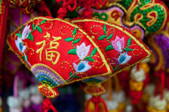 Chinese handicrafts. Some fan shaped red chinese perfume bag Royalty Free Stock Photography