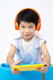 Chinese happy Boy Using Tablet Computer with headphone Stock Photos