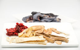 Chinese herb and spice with black chicken. For soup preparation on white background Stock Image