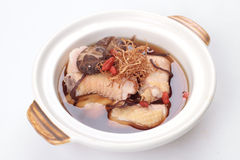 Chinese herbal chicken soup in claypot Stock Photography