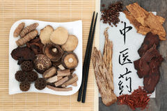 Chinese Herbal Medicine. Selection with chopsticks and calligraphy script on rice paper. Translation reads as Stock Images