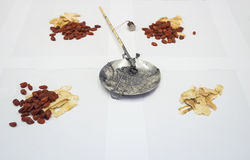 Chinese Herbal medicine with Traditional weight scale Royalty Free Stock Photos