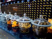 Chinese herbal medicines in the pharmacy filled glass containers Stock Photo