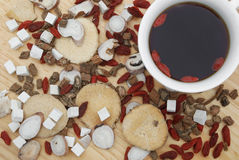 Chinese herbs blends and herb tea on wood Royalty Free Stock Photography