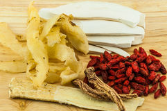 Chinese herbs on wood background. Concept for healthy & medical Royalty Free Stock Photography