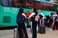 Chinese high school students in waiting for the bus back to school Royalty Free Stock Photo