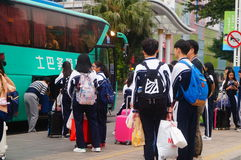 Chinese high school students in waiting for the bus back to school Royalty Free Stock Photography