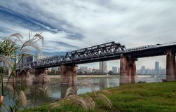 Chinese high speed rail transportation. Chinese high speed rail running on steel bridge royalty free stock photo