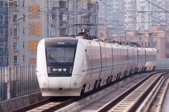 Chinese high speed train at city Stock Photos