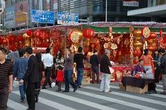 Chinese holiday - decoration stalls. CHINA, SHENZHEN - FEBRUARY 10: Chinese people searching colorful decorations for Chinese New Year on February 10, 2010 in Royalty Free Stock Image