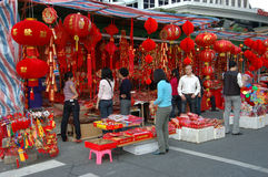 Chinese holiday - decoration stalls. CHINA, SHENZHEN - FEBRUARY 10: Chinese people searching colorful decorations for Chinese New Year on February 10, 2010 in Royalty Free Stock Photography