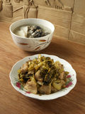 Chinese homely dinner. Sour pickle stir fried with meat and slow cooked medical chicken yam soup stock images