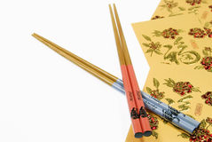 Chinese Horse and Snake Chopsticks With Gold Money Wallets, Chinese New Year Royalty Free Stock Photo