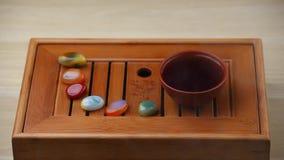 Chinese hot tea cup bamboo desk sandal aroma sticks hd footage. Studio stock video