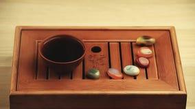 Chinese hot tea cup bamboo desk sandal aroma sticks hd footage. Studio stock video footage