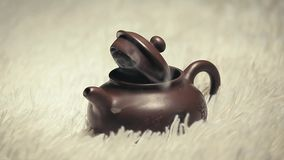 Chinese hot teapot smoke wool background nobody. Studio stock video