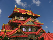 The Chinese house. On a background of the sky Stock Photos