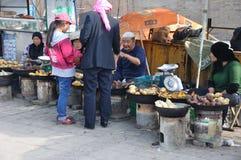 Chinese hui street vendor. Selling roasted sweet potatoes, in Xining,Qinghai,China Stock Image