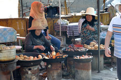 Chinese hui street vendor. Selling roasted sweet potatoes, in Xining,Qinghai,China Royalty Free Stock Photography