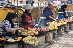 Chinese hui street vendor. Selling roasted sweet potatoes, in Xining,Ganshu,China Royalty Free Stock Images