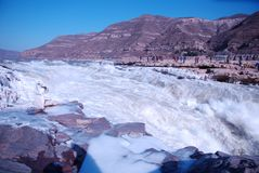 Chinese Hukou Waterfall freezing in winter Royalty Free Stock Photography