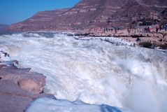 Chinese Hukou Waterfall freezing in winter Royalty Free Stock Image