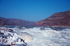 Chinese Hukou Waterfall freezing in winter. Hukou Waterfall on the Yellow River is the only yellow Great Falls, is China's second largest waterfall, known as Royalty Free Stock Photos