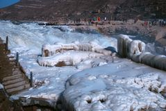 Chinese Hukou Waterfall freezing in winter. Hukou Waterfall on the Yellow River is the only yellow Great Falls, is China's second largest waterfall, known as Stock Photos