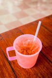 Chinese ice tea in plastic cup on the table Royalty Free Stock Photography