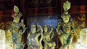 Chinese idol sculptures in antique shop Stock Photos