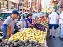 Chinese immigrants selling exotic fruits at Chinatown in New York City Royalty Free Stock Images