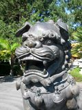 Chinese Imperial guardian lion statue. Close up of a Chinese Imperial guardian lion statue Stock Image
