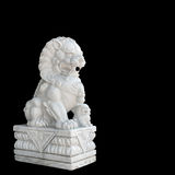 Chinese Imperial Lion statue isolated on black background Stock Photo