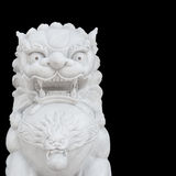 Chinese Imperial Lion statue isolated on black background Stock Images