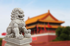 Chinese Imperial Lion Statue with Palace Forbidden city  (Beijin Royalty Free Stock Photo