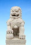 Chinese Imperial Lion Statue with sky Royalty Free Stock Photo