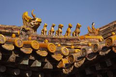 Chinese imperial roof decoration or roof charms, or roof figures with emperor and creatures in the Forbidden City in Beijing, Chin