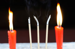 Chinese incense and red candle Stock Images