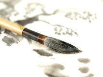 Chinese Ink Brush. A chinese ink brush on a paper Royalty Free Stock Images