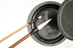 Chinese inkstone and brushs stock image