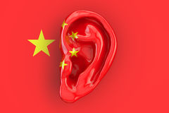 Chinese intelligence concept, ear on the flag of China. 3D rendering. Chinese intelligence concept, ear on the flag of China. 3D stock illustration