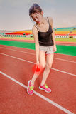 Chinese jogger with injured leg, throbbing pain Stock Photography